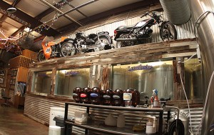 The keg cold storage topped with vintage bikes.